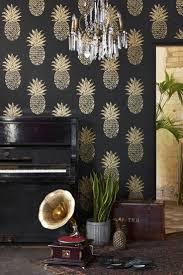 screen background image handy living: a large scale pineapple motif wallpaper with a hand printed effect shown in metallic