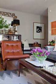 cognac caramel leather chair tufted tufting west elm rug grey gray charcoal ikat modern art black and white color palette neutral living room mid century bedroomendearing living grey room ideas rust