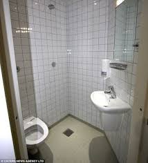 inmates bathroom size cages