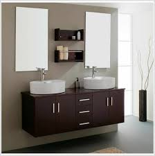 engaging modern bathroom design with white and brown bathroom cabinet also white washbasin complete with white bathtub and towel rack also white rug on brown bathroom furniture