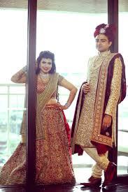 17 best images about lehenga love❤ mehendi vikram a heavily embroidered cream colored sherwani by sabyasachi paired a maroon velvet dupatta for groom nikhil of weddingsutra