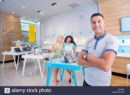 store assistant in computer store customers stock photo stock photo store assistant in computer store customers