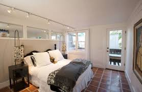 view in gallery perfect way to combine track lighting with a couple of lovely floor lamps bedroom track lighting ideas