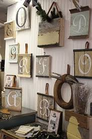 letter wall art painted on woodnow to go get some barn wood ideas