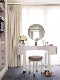 round white marble dining table: on dark grey flooring base and small white wooden drawer vanity sets
