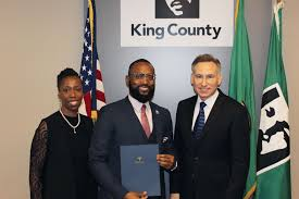 bridge graduates embody king county s spirit of service kc primary bridge facilitator debra baker graduate anttimo bennett kscs and king county executive dow constantine