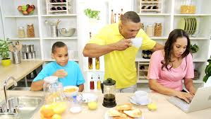 preparing family breakfast kitchen busy african american family kitchen mom wireless laptop little africa
