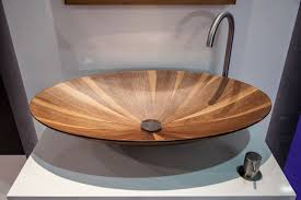 bathroom countertop basins wholesale: this wooden countertop basin is a stunning piece for any modern bathroom