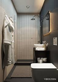 architecture bathroom toilet: low profile horizontal tiles make the bathroom feel wider and their uniform arrangement draws attention to the height of the ceiling a smart choice for a