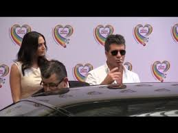 Simon Cowell Arrives at the Health Lottery Tea Party Smoking a ...
