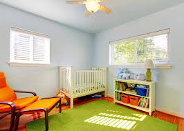 baby nursery room with soft pale blue walls large lime green rug cream crib bedroomadorable eames style