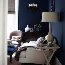 midnight blue wall living room tanzanite blue wall blue walls brown furniture