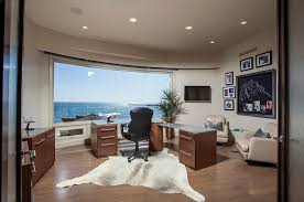 classy home office with captivating ocean view and wood table also wood vanity with black swivel awesome office table top view