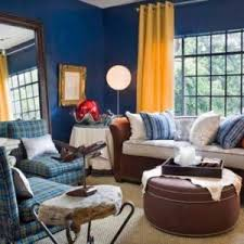 condo living room design with navy blue wallirror and blue walls brown furniture
