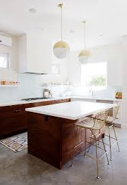 guy kitchen meg: love the crisp contemporary white cabinet uppers against the rich wood of some of the lowers amp island the gold ties it up