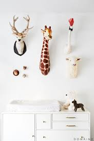 x plush wall: nursery with faux animal heads mounted on wall