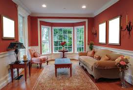 warm living room ideas: warm living room remodeling idea with window bay set beige velvet fabric armchair cushion sofa dark brown furnished wood coffee table pink leather sofa