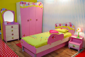 youth bedroom sets girls: playful girls bedroom with pink and green color scheme and fun furniture