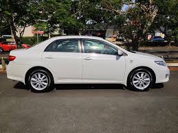 Image result for white 2009 toyota corolla