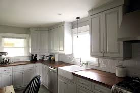 kitchen moldings: its easy to update the look of your old kitchen cabinets with some simple mouldings and