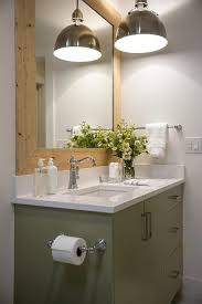 barnboards to frame mirror an antique nickel pendant light brightens the bathroom vanity with an industrial finish that will patina over time bathroom vanity barnwood mirror oyster pendant lights