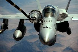 aircraft armament equipment aae fuel containment navair u s an f a 18 executes in flight refueling through an aerial refueling system logo