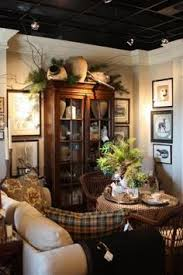 ideas china hutch decor pinterest: this i think is a store vignette so appears cluttered the idea of the framing the tall cabinet with those pictures and the use of the top of it are