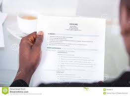 person reading resume stock photo image  person reading resume
