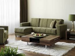space living room olive: stained hardwood for the flooring matches that of the coffee table and side tables the