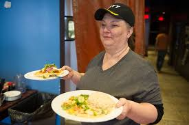 the tipping point is blue dream curry paving the way for no tip changing times server deena jackson brings food out at blue dream curry house blue