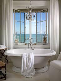 elegant chandelier and vintage bathtub shape a dreamy bathroom design jill shevlin design bathroom chandelier lighting ideas