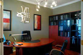 office design option featuring curves wooden desk and black leather swivel chairs black leather office design