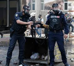 day rioters clash police as protests break out worldwide at the ready two riot police officers prepare their weapons as clashes erupt after the