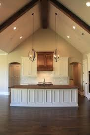 kitchen ceiling lighting design. vaulted ceiling wood countertop island in kitchen parade of homes 2014 flooring exposed beams lighting design