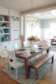 notice the wood table with the bench in a white setting casual dining room lighting