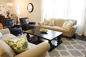 rug for living room with white sofa and colorful pillow with rectangle black table black beige living room