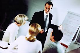 what you need to know about marketing consultant jobs businessman giving presentation to colleagues