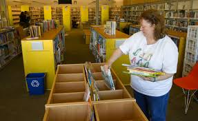 troutdale library to open after years of delays view full sizedoug beghtel the oregonian library page ruth ruby selects books to fill book bins children s books as final preparations are made to