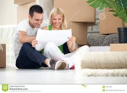 Couple Looking At House Plans Stock Photo   Image  Couple looking at house plans