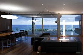 the arco lamp is an iconic piece of modern lighting originally designed by achille castiglioni and pier giacomo castiglioni in 1962 arco lighting