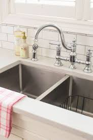 undermount kitchen sink stainless steel: this kitchen makes me want to go ahead with lagoon suede finish i love this faucet it is waterhill in chrome by moen the counter is silestone lagoon in a