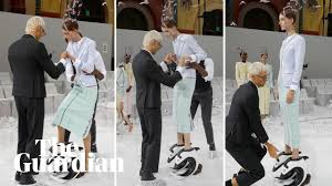 Models helped into 'extreme' shoes during Paris <b>fashion</b> week ...
