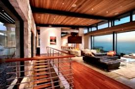 a family room with a marvelous interior design equipped with sofas and cushions and a table with a white carpet with a light brown color on the wooden roof awesome family room lighting