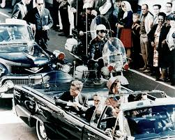 john f  kennedy conspiracy theories debunked  why the magic bullet    picture of president kennedy in the limousine in dallas  texas  on main street