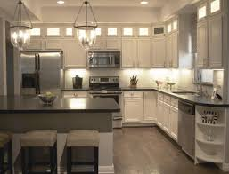 clean white themed traditional kitchen with kitchen pendant lighting and hardwood flooring appealing pendant lights kitchen
