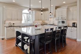 small three black cast iron pendant lamp over black wooden island with glass shade appealing appealing pendant lights kitchen
