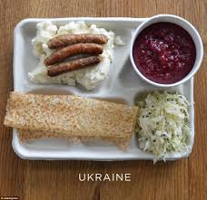 photos of school lunches served around the world reveal how meager a serving of borscht beetroot soup pickled cabbage sausages and mash