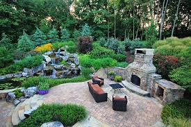 outdoor fireplace paver patio: wh pavers patio stone outdoor fireplace lush plantings