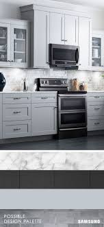 black and stainless kitchen what does your dream home look like marble countertops neutral backsplash dark trim whatever your ideal combination the black stainless steel of the