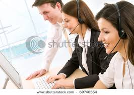 Women_at_Work_As_Telephone_Operators_in_a_Call_Center_Providing_Customer_Support_with_Their_Supervisor_Helping_out_Picture_Pictures_Stock_Photo_111129- ... Women at Work As Telephone Operators in a Call Center Providing Customer Support with Their Supervisor